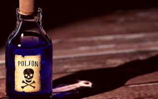 a bottle of poison sits alone