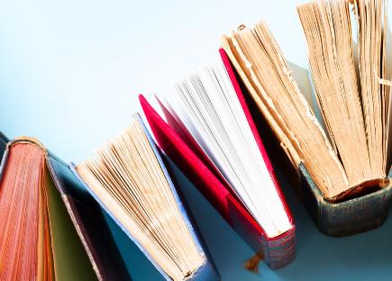 books arranged on a curve
