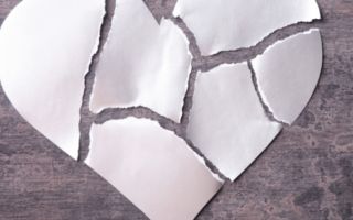 a paper heart torn into pieces