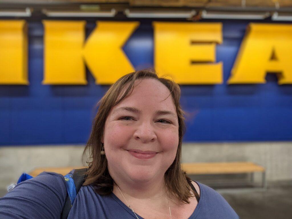 Liz smiles outside the KC IKEA