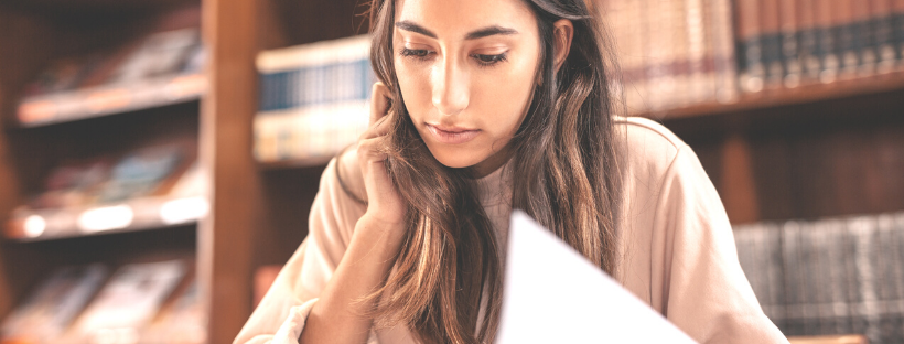 A woman at a library doing research